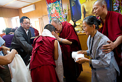 Dalai Lama gives blessings to Dawa Zhuoma, 11, a Chinese American girl from Los Angeles, CA,  after the audience meeting in Dharamsala, India, May 26, 2009.
