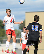 LANGHORNE, PA - SEPTEMBER 22: Neshaminy's Devlin Mettee #15 heads the soccer ball as Central Bucks South's Danny Remick #15 looks on in the first half September 22, 2014 in Langhorne, Pennsylvania. (Photo by William Thomas Cain/Cain Images)
