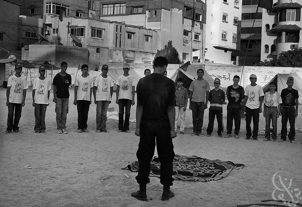 A HAMAS trainer works with a group of Palestinian boys August 04, 2007 at a HAMAS sponsored summer camp in Gaza City, Gaza. Kids at the camp are given military style training 6 days a week at the camp for 3 hours per day.