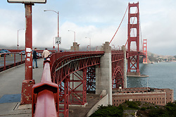 Approaching The Golden Gate Bridge on foot from the South. Fort Point, Arch, the Golden Gate. In this shot: Pete and Bill Greeley ahead of me.