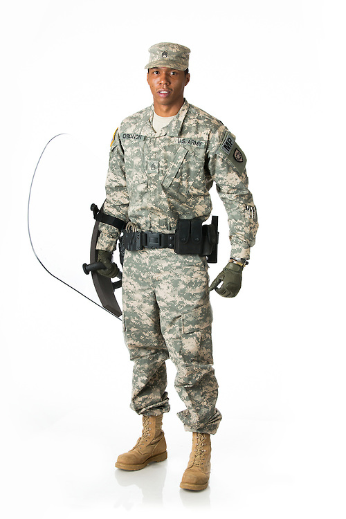 Srgt. Edwin O'Bannon posed for portraits to be used in GX Magazine, Thursday, Jan. 16, 2014 at Palmer Photo Studio in Lexington.