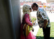 Married last month, celebrity impersonators CJ Morgan as Dolly Parton and RL Bullard as Jack Nicholson take a quick break in the shade while making their rounds through the Ohio State Fairgrounds on July 25, 2013. (Adam Cairns / The Columbus Dispatch)