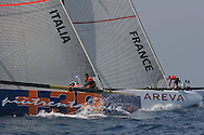 Italy's +39 Challenge battles neck and neck with France's Areva Challenge team in America's Cup fleet race; Valencia, Spain.