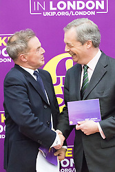 Emmanuel Centre, Westminster, London, April 19th 2016. UKIP Mayoral candidate Peter Whittle shakes hands with party leader Nigel Farage as UKIP launches their London Mayoral campaign manifesto.