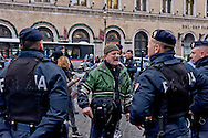 Rome, Italy. 5th January 2016<br /> Protester protesting  his arrest  during a protest against evictions in  in Rome's Piazza Santi Apostoli.