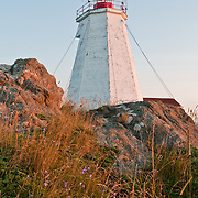 The Swallowtail Lighthouse on Grand Manan Island. This lighthouse greets all those arriving to Grand Manan by ferry. It opened on July 7, 1860, after a series of shipwrecks on the north coast of Grand Manan. In one wreck, the 1,0009 ton 'Lord Ashburton' sunk during a midnight gale, taking the lives of 21 crewmen. For the past 150 years the lighthouse has guided sailors, and been an iconic emblem of Grand Manan. Photo by William Drumm.