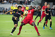 LAFC forward Carlos Vela (10) battles against Toronto FC defender Chris Mavinga (23)  during a MLS soccer game between the LAFC and the Toronto FC. LAFC and Toronto FC tied 1-1 on Saturday, Sept 21, 2019, in Los Angeles. (Ed Ruvalcaba/Image of Sport)