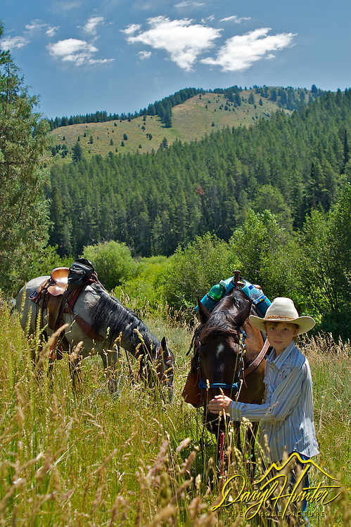 Young Cowboy on trail ride in Swan Valley Idaho
