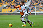 Derby County defender Max Lowe (25) skips pastWolverhampton Wanderers midfielder Wander Helder Costa (17) 0-2 during the EFL Sky Bet Championship match between Wolverhampton Wanderers and Derby County at Molineux, Wolverhampton, England on 5 November 2016. Photo by Alan Franklin.
