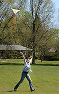 Tracey Gonzalez of Abington, Pennsylvania flies a kite during Kite Day Sunday April 24, 2016 at the Fonthill Museum in Doylestown, Pennsylvania. (Photo by William Thomas Cain/Cain Images)