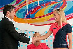 Aleksander Batic, executive director of the Nova KBM, and Simona Fabjan at Fabjan Sisters Press Conference about signing sponsorship contract with Nova Kreditna Banka Maribor, on May 24, 2011 in NKBM Poslovalnica Ljubljana, , Slovenia. (Photo by Matic Klansek Velej / Sportida)