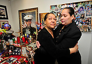 The mother and sister of Lance Cpl. Robert Marcus Rodriguez, Amarilys and Moura Hernandez embrace in a room filled with memories of Rodriguez, the first soldier from New York to be killed in Iraq on March 25, 2003.