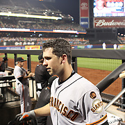 Buster Posey, San Francisco Giants, returns to the dugout after batting during the New York Mets Vs San Francisco Giants MLB regular season baseball game at Citi Field, Queens, New York. USA. 11th June 2015. Photo Tim Clayton