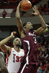 02 February 2013:  Desmar Jackson gets free and clear of Jackie Carmichael and takes a shot for the hoop during an NCAA Missouri Valley Conference mens basketball game where the Salukis of Southern Illinois lost to the Illinois State Redbirds for Retro-Night 83-47 in Redbird Arena, Normal IL