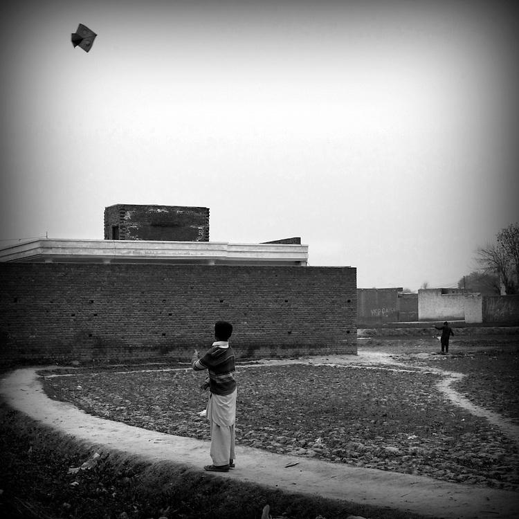 Peshawar. Kids are playing with kites.
