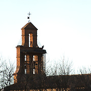 Two storks by their nest on a bell tower at Zamora.