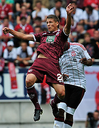 24.07.2010, Fritz-Walter Stadion, Kaiserslautern, GER, 1. FBL, Friendly Match, 1.FC Kaiserslautern vs FC Liverpool, im Bild Ivo ILICEVIC (Kaiserslauern #22 KRO) im Kopfballduell mit David NGOG (Liverpool #9), EXPA Pictures © 2010, PhotoCredit: EXPA/ nph/  Roth+++++ ATTENTION - OUT OF GER +++++