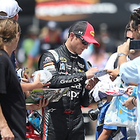 Sprint Cup Series driver Kasey Kahne (5) signs autographs during the 57th Annual NASCAR Coke Zero 400 race first practice session at Daytona International Speedway on Friday, July 3, 2015 in Daytona Beach, Florida.  (AP Photo/Alex Menendez)