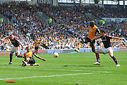 Hull City midfielder Mohammed Diame (17) takes a shot at goal from close range  during the Sky Bet Championship match between Hull City and Rotherham United at the KC Stadium, Kingston upon Hull, England on 7 May 2016. Photo by Ian Lyall.
