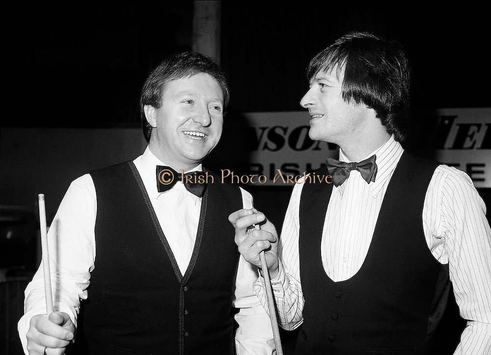 Two world champions from Northern Ireland: Dennis Taylor and Alex 'Hurricane' Higgins at the Benson & Hedges Irish Masters snooker tournament at Goffs, Kill, County Kildare. After making it through to the final several times, Higgins finally won the tournament in 1989.<br />