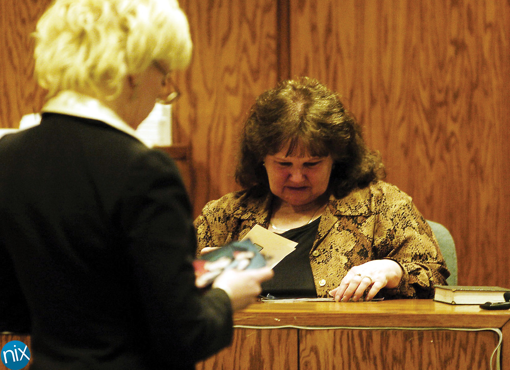 Norma Greene, mother of Lisa Greene, cries on the stand Friday, Jan. 4, 2008 while Defense Attorney Lisa Dubbs shows her photos of her grandchildren Daniel and Addison Macemore, both who died in a 2007 mobile home fire. Lisa Greene is charged with the double murder and arson. Norma Green is the first witness called by Lisa Greene's defense. (AP photo, Independent Tribune, James Nix)