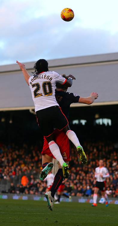 20. Hugo Rodallega winning header during the Sky Bet Championship match between Fulham and Reading at Craven Cottage, London, England on 17 January 2015. Photo by Matthew Redman.