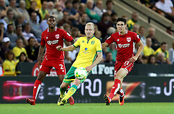 Steven Naismith of Norwich City passes the ball under pressure from Callum O'Dowda of Bristol City - Mandatory by-line: Robbie Stephenson/JMP - 16/08/2016 - FOOTBALL - Carrow Road - Norwich, England - Norwich City v Bristol City - Sky Bet Championship