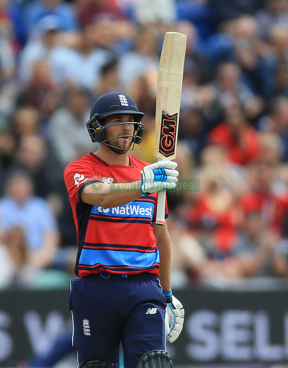 England's Dawid Malan raises his bat after reaching his half century during the T20 match at the SSE SWALEC, Cardiff.