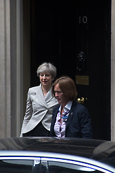 June 13, 2017 - London, England, United Kingdom - British Prime Minister, Theresa May, leaves 10 Downing Street after a talk with Democratic Unionist Party (DUP), Arlene Foster, London on June 13, 2017. Prime Minister and Conservative Party leader Theresa May, was heading into difficult talks with the DUP on securing a working majority after a crushing electoral setback. (Credit Image: © Alberto Pezzali/NurPhoto via ZUMA Press)