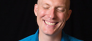 Informal head shot of laughing TED speaker, Boulder, CO