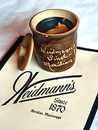 A peanut butter crock sits on the table at Weidmann's Restaurant Jan. 16, 2011 in Meridian, Mississippi. The restaurant, which opened in 1870 and is the oldest restaurant in Mississippi, is well-known for its unusual offering of peanut butter and crackers for diners to enjoy while waiting for their meal. (Photo by Carmen K. Sisson/Cloudybright)