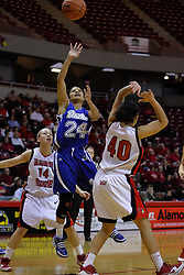 31 December 2009: Brittnye McSparron gets inside of Amanda Clifton and Ashleen Bracey for a short jump shot. The Bulldogs of Drake fall to the Redbirds of Illinois State University by a score of 77-58in a Missouri Valley Conference game on Doug Collins Court in Redbird Arena in Normal Illinois.