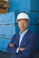 Portrait of manager wearing hard hat with arms crossed