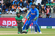 Mushfiqur Rahim (wk) of Bangladesh hits the ball to the boundary for four runs during the ICC Cricket World Cup 2019 match between Bangladesh and India at Edgbaston, Birmingham, United Kingdom on 2 July 2019.