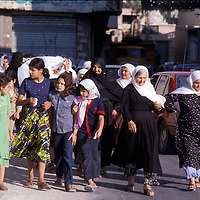 1981 Women and yuong girls of Qana, Lebanon take an evening walk.