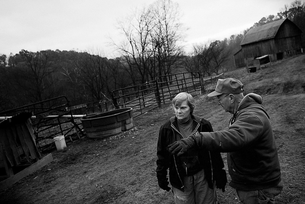 Dave Bircher, 71, and his wife, Nancy discuss the farm chores for the day on November 10, 2007. Bircher has farmed the rolling hills of Southeast Ohio for more than thirty years. 'Honestly, we're farming because we love to farm. We're not farming because we're making any money,' says Bircher.