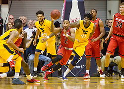 Mar 2, 2016; Morgantown, WV, USA; Texas Tech Red Raiders guard Devon Thomas (2) grabs a rebound during the first half against the West Virginia Mountaineers at the WVU Coliseum. Mandatory Credit: Ben Queen-USA TODAY Sports
