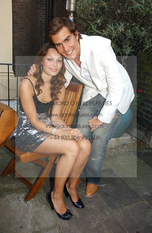 OSCAR HUMPHRIES and SARA PHILIPPIDIS at the Tatler Summer Party 2006 in association with Fendi held at Home House, Portman Square, London W1 on 29th June 2006.<br />