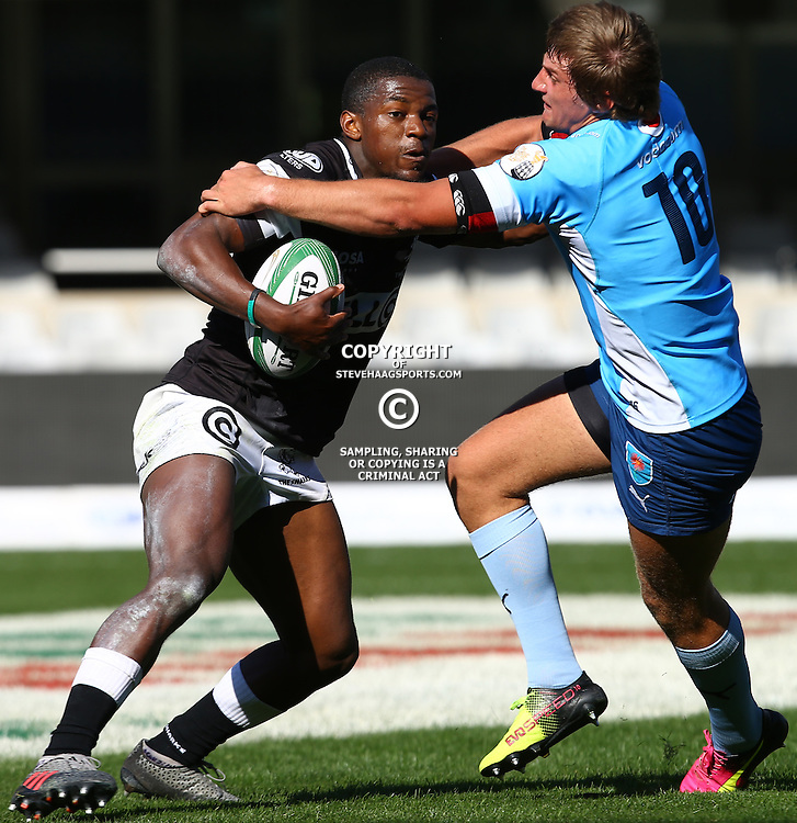 DURBAN, SOUTH AFRICA, 27 August, 2016 - Mfundo Ndlovu of the Cell C Sharks Under 19&rsquo;s hands off Boeta Hamman (c) of the Vodacom Blue Bulls U19 during the match between The Cell C Sharks U19 and the Blue Bulls U19, Currie Cup Under 19 Competition at Growthpoint Kings Park in Durban, South Africa. (Photo by Steve Haag)<br /> <br /> images for social media must have consent from Steve Haag