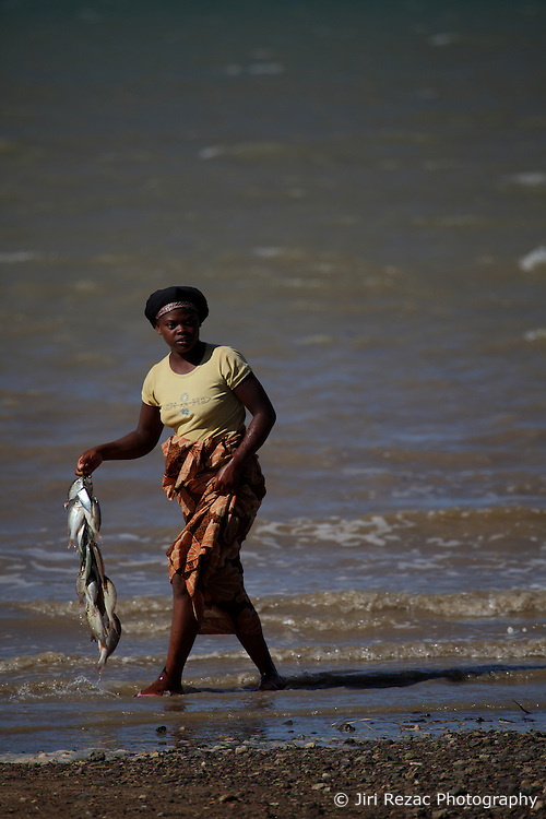 MADAGASCAR ANTSIRANANA 14MAY13 - A l0cal women acting as fish sellers cleans the catch on the beach at Baie Andovobazaha near Antsiranana, Madagascar.<br /> <br /> <br /> jre/Photo by Jiri Rezac / Greenpeace
