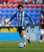 Wigan Athletic midfielder Bo-Kyung Kim during the Sky Bet Championship match between Wigan Athletic and Brighton and Hove Albion at the DW Stadium, Wigan, England on 18 April 2015.