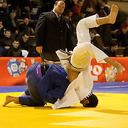 Visé - January 30 : Madda Loni MARCO (blue) from Italy compete with  Guillaume CHAINE from France in the final match of Men's -73 Kg during the Judo Open International 2010 in Visé, Belgium. MARCO won the match.