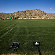 NBC Sports and Golf Channel crews begin the process of producing the WGC Accenture Match Play golf tournament by building studio sets, camera towers, and laying fiber optic cable.