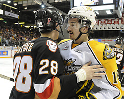 Brothers Michael Stone (left) of the Calgary Hitmen and Mark Stone of the Brandon Wheat Kings after the semi-final game of the 2010 MasterCard Memorial Cup in Brandon, MB on Friday May 21. Photo by Aaron Bell/CHL Images