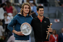 May 12, 2019 - Madrid, Madrid, Spain - Stefanos Tsitsipas from Greece and Novak Djokovic from Serbia are seen after the Mutua Madrid Open Masters final match on day eight at Caja Magica in Madrid..Novak Djokovic beats Stefanos Tsitsipas. (Credit Image: © Legan P. Mace/SOPA Images via ZUMA Wire)