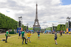 Ireland fans play football in the Paris Fanzone at the Eiffel Tower, while waiting for the next game to start on the big screens. Images from the UEFA EURO 2016, 14 June 2016 in Fan Zone. (c) Paul Roberts | Edinburgh Elite media. All Rights Reserved