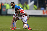 Stoke City forward Saido Berahino (19) and 42 Anthony Grant for Shrewsbury Town during the The FA Cup 3rd round match between Shrewsbury Town and Stoke City at Greenhous Meadow, Shrewsbury, England on 5 January 2019.