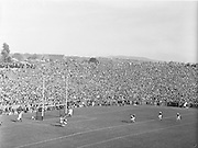 Thousands of spectators on Hill 16, watch Kerry goalie J Cullotty save the ball at the start of the All Ireland Senior Gaelic Football Championship Final, Kerry vs Galway in Croke Park on the 27th September 1959. Kerry 3-7 Galway 1-4.