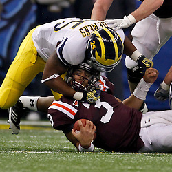 January 3, 2012; New Orleans, LA, USA; Michigan Wolverines linebacker Kenny Demens (25) tackles Virginia Tech Hokies quarterback Logan Thomas (3) during the first quarter of the Sugar Bowl at the Mercedes-Benz Superdome.  Mandatory Credit: Derick E. Hingle-US PRESSWIRE