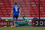 Fine save from Oldham Athletic goalkeeper David Cornell   during the The FA Cup match between Sheffield Utd and Oldham Athletic at Bramall Lane, Sheffield, England on 5 December 2015. Photo by Simon Davies.